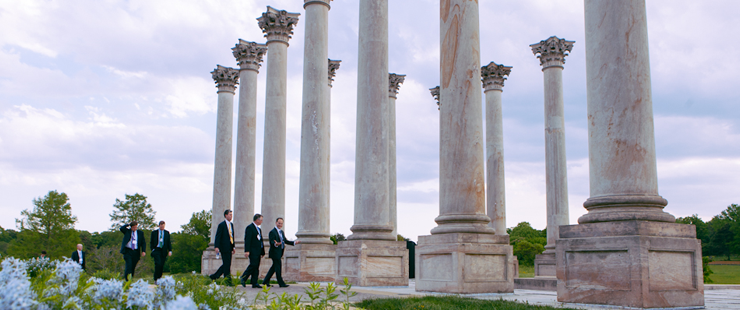 Groomsman among the capital columns